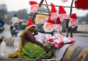 Santa Claus masks sold on roadside in Ahmedabad
